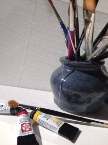 Plexiglass, watercolor paints, and brushes. Tools for inspiration