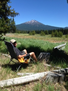 Hubby relaxing at the campsite. Mt Bachelor in the background.