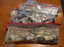 Cindy Briggs organizes her paint tubes in plastic bags