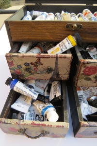 Organized paint tubes in a wooden drawer box!
