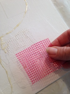 Onion netting cut in squares and added to the canvas creates a grid-texture