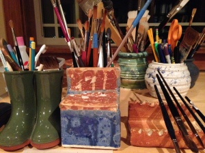 Random ceramic containers for paint brushes and pencils