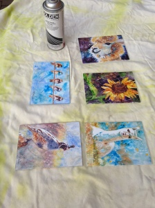 I lay the paintings on an old sheet, and spray them with several coats of varnish.