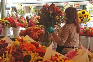Flower vendor carrying flowers